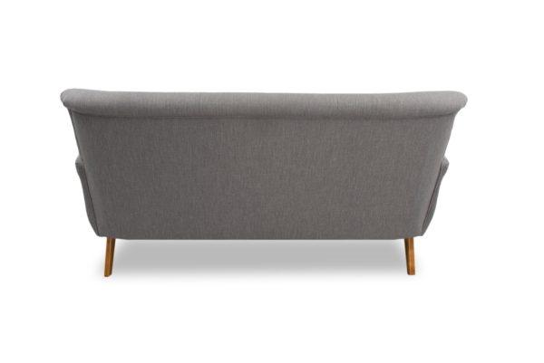 Brita kolmen istuttava harmaa sohva, verhoiltu käsinoja.